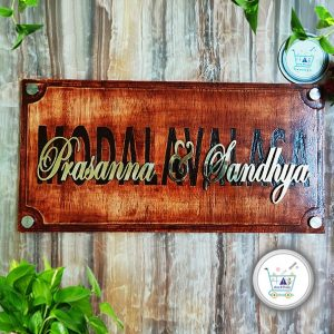 wooden name plate with brass letters